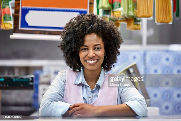 portrait of smiling female cashier at store - pardo brazilian stock pictures, royalty-free photos & images
