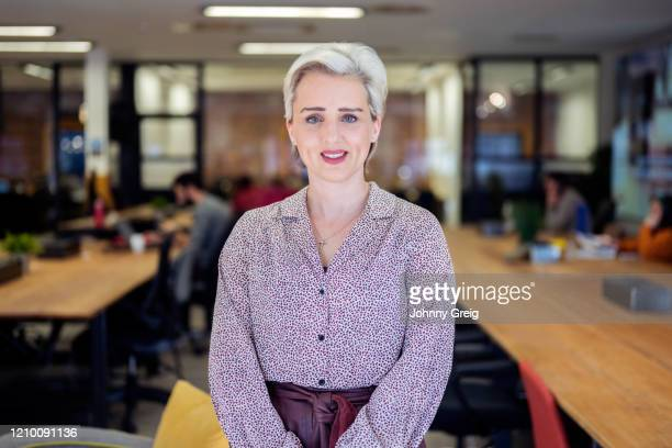 portrait of smiling female ceo and entrepreneur - femalefocuscollection stock pictures, royalty-free photos & images