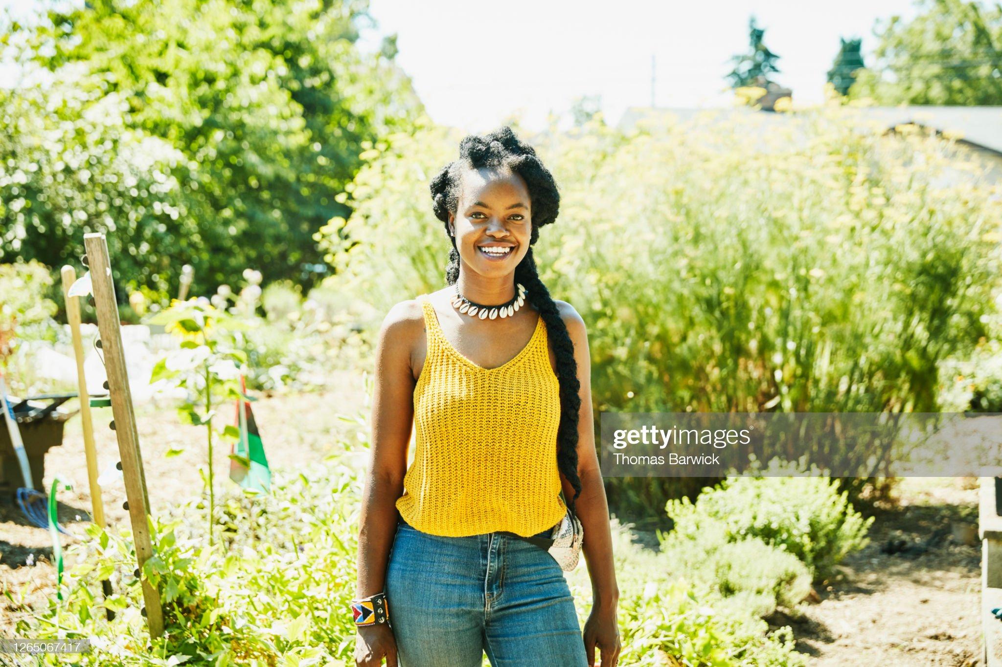 Portrait of smiling female farmer on urban farm : Stock Photo