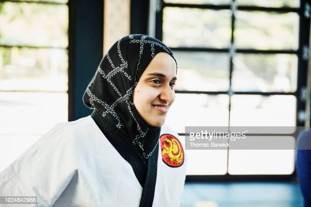 Portrait of smiling female Muslim self defense instructor in gym