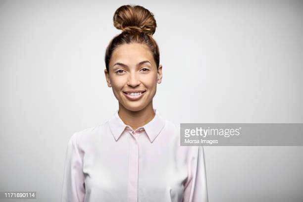 portrait of smiling female owner with hair bun - up do stock pictures, royalty-free photos & images
