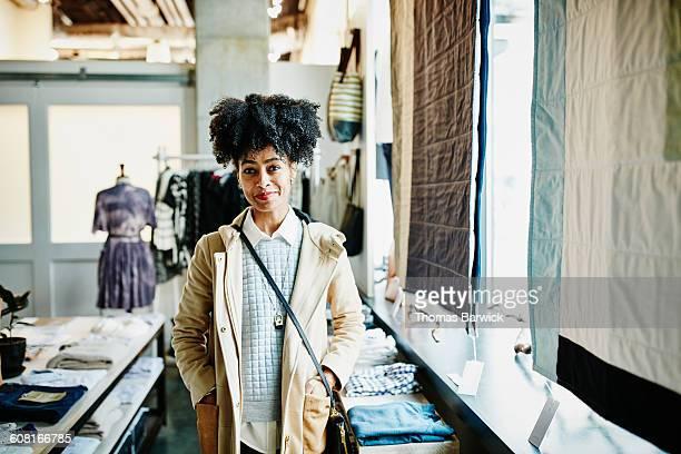 Portrait of smiling female shopper in boutique