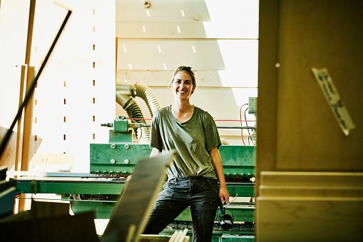 Portrait of smiling female woodworker in cabinet shop - gettyimageskorea