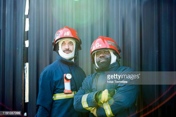 Portrait of smiling firefighter rescue in protective uniform. Emergency safety and Protection rescue from danger.