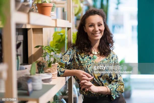 Portrait of smiling florist in flower shop