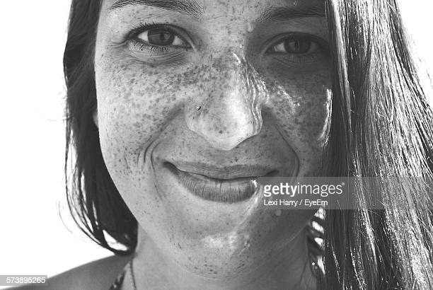 Portrait Of Smiling Freckled Woman