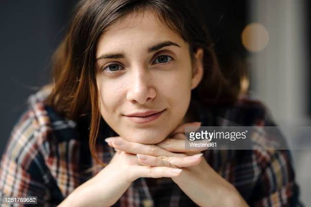 portrait of smiling freelancer - hand on chin stock pictures, royalty-free photos & images