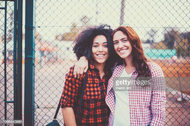 Portrait of smiling friends at the schoolyard