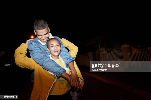 portrait of smiling friends standing on street - petite amie photos et images de collection