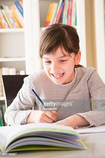Portrait of smiling girl drawing something