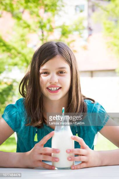 Portrait Of Smiling Girl Having Milk