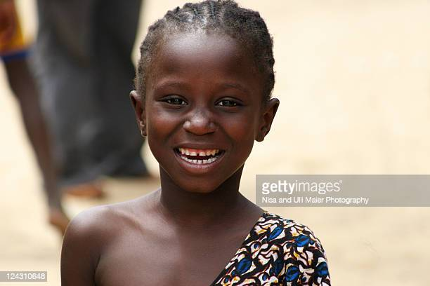 Portrait of smiling girl in Dakar, Senegal.