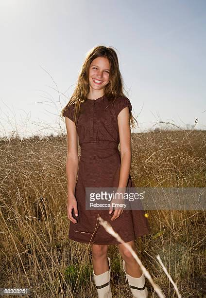 portrait of smiling girl in field - emery stock photos and pictures