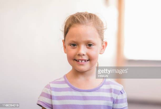 portrait of smiling girl in school - junior level stock pictures, royalty-free photos & images