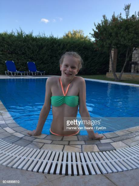 Portrait Of Smiling Girl In Swimming Pool
