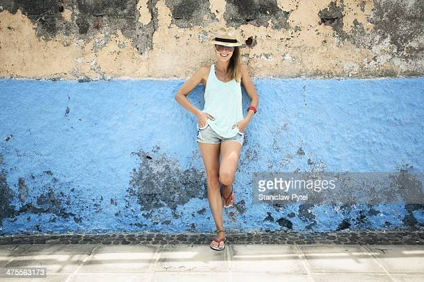 portrait of smiling girl on colorful wall - hot pants stock pictures, royalty-free photos & images