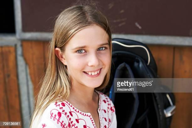 Portrait of smiling girl on horse farm