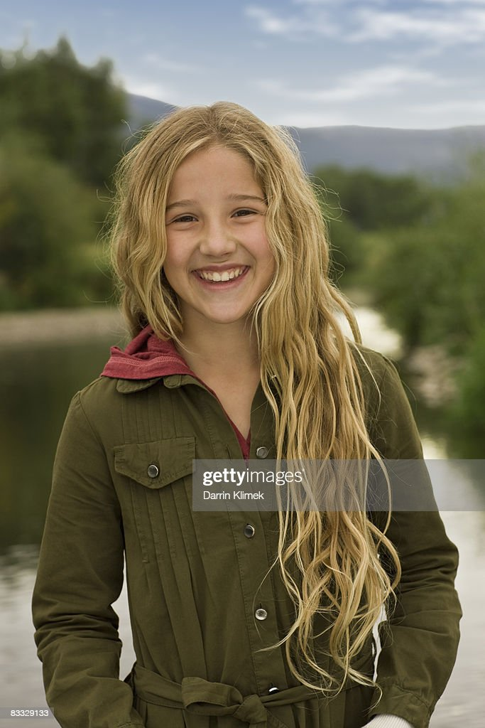 Portrait of smiling girl outdoors  : Stock Photo