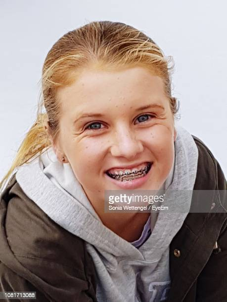 portrait of smiling girl - beautiful girl smile braces vertical stock photos and pictures