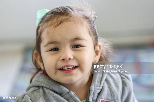 portrait of smiling girl - steven cottingham stock-fotos und bilder