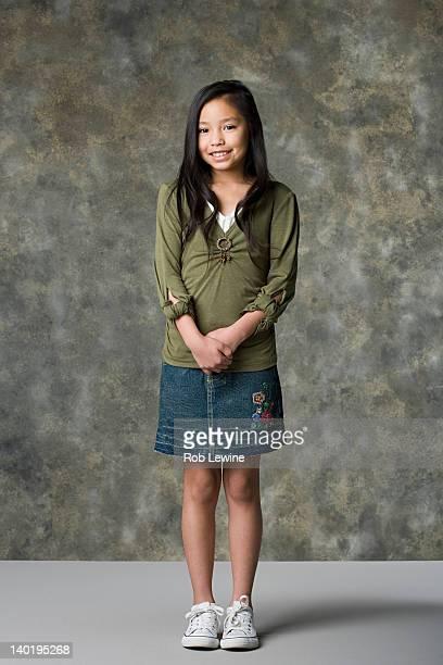 Portrait of smiling girl (8-9), studio shot