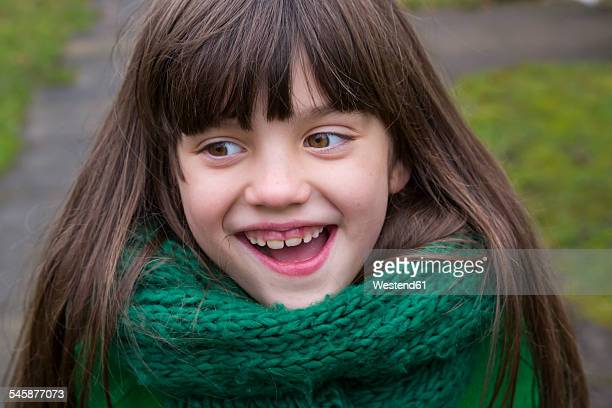 Portrait of smiling girl wearing green scarf