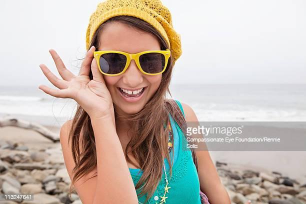Portrait of smiling girl wearing sunglasses