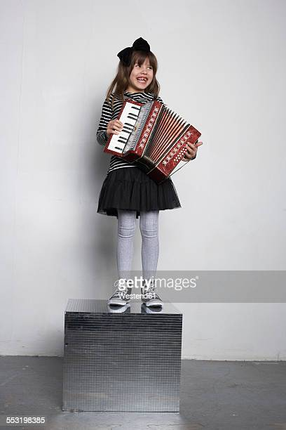 Portrait of smiling girl with accordion