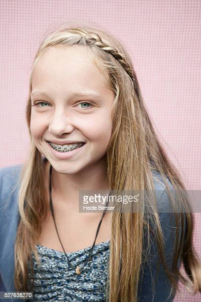portrait of smiling girl (13-15) with braces - beautiful girl smile braces vertical stock photos and pictures