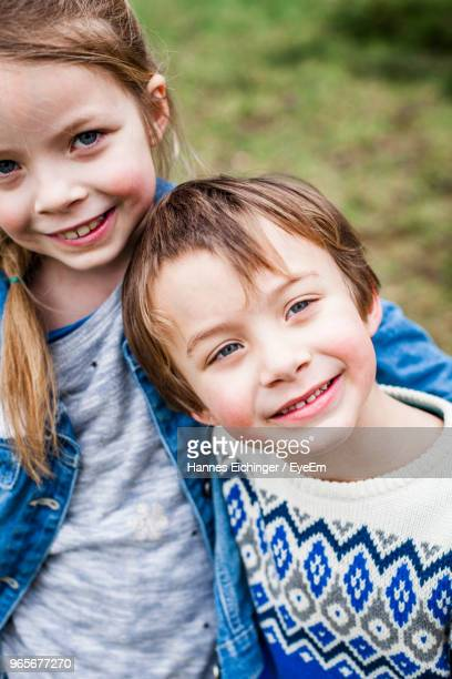 Portrait Of Smiling Girl With Brother