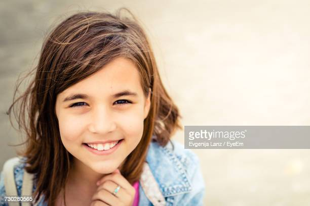 Portrait Of Smiling Girl With Brown Hair