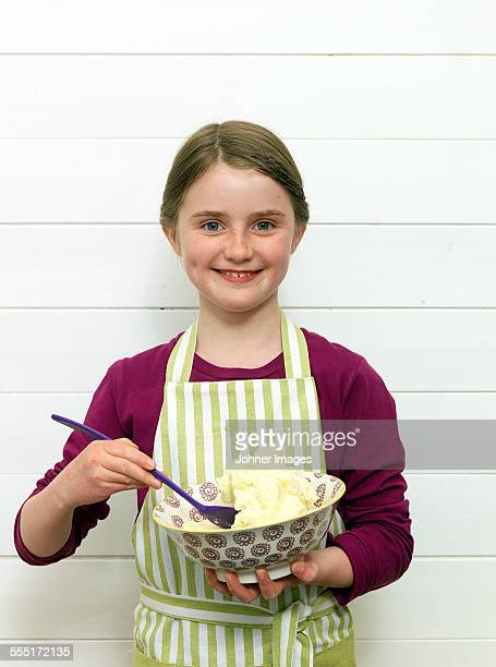 Portrait of smiling girl with mixing bowl