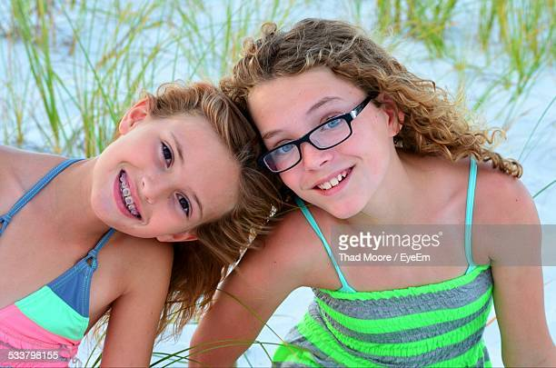Portrait Of Smiling Girls On Beach In Summer