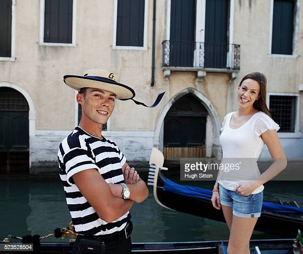 portrait of smiling gondola driver and female tourist - hugh sitton stock pictures, royalty-free photos & images