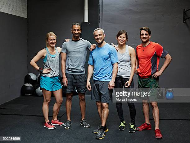 portrait of smiling gymters - side by side stock pictures, royalty-free photos & images
