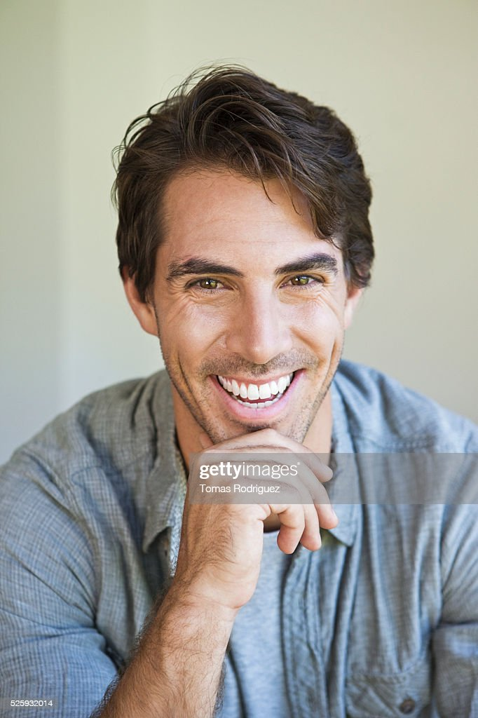 Portrait of smiling handsome man : Stock Photo
