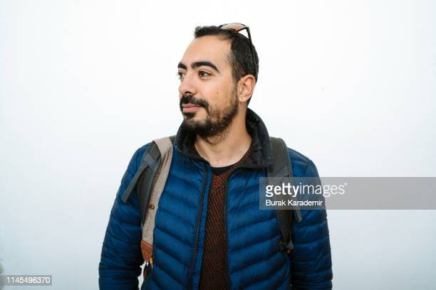 portrait of smiling handsome man with mustache in blue jacket looking sideways - mannelijke gelijkenis stockfoto's en -beelden