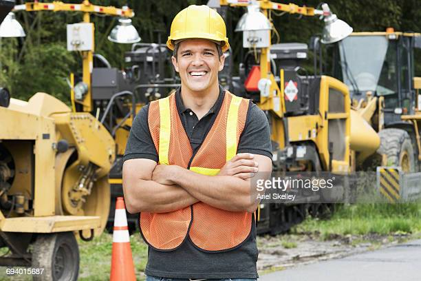 Portrait of smiling Hispanic construction worker