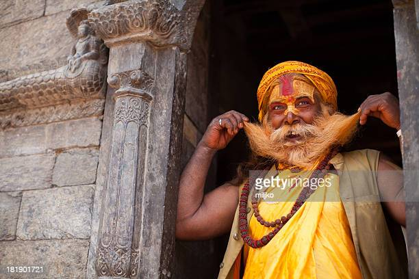 portrait of smiling holy sadhu man - varanasi stock pictures, royalty-free photos & images