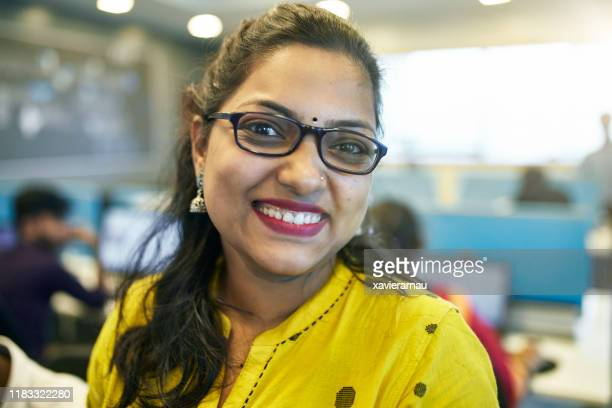 portrait of smiling indian businesswoman in early 30s - bindi stock pictures, royalty-free photos & images