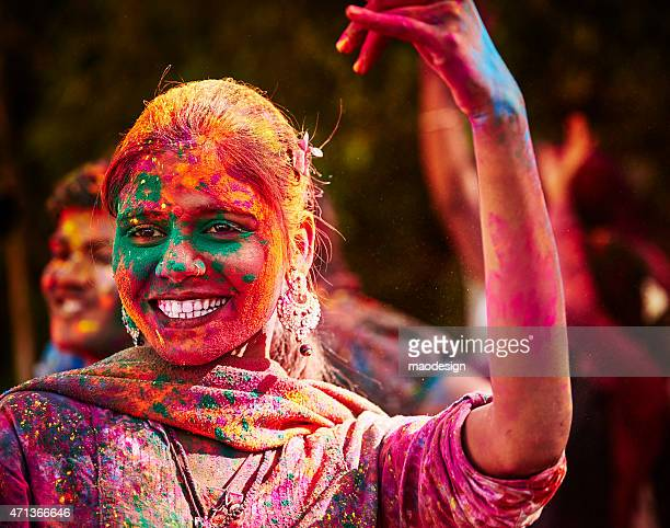 Portrait Of Smiling Indian Girl With Colored Face During Holi
