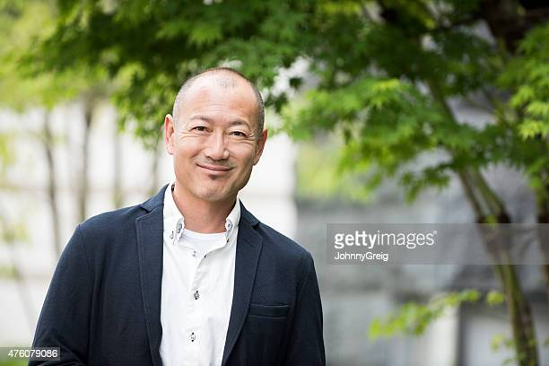 portrait of smiling japanese man - only japanese stock pictures, royalty-free photos & images