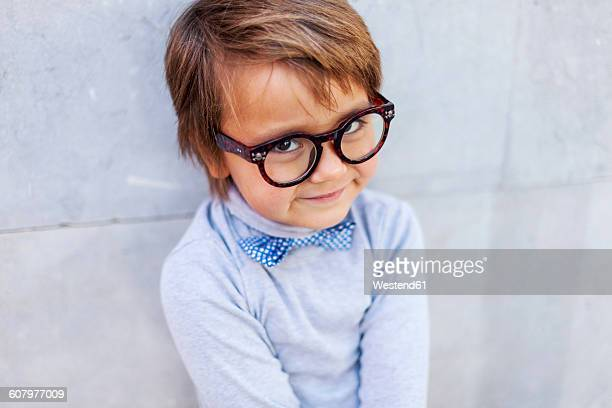 Portrait of smiling little boy wearing oversized spectacles