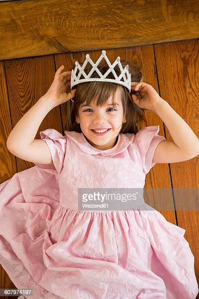 Portrait of smiling little girl dressed up as a princess