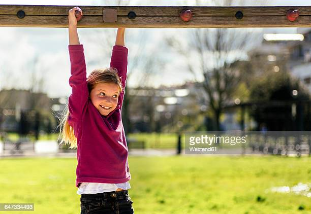Portrait of smiling little girl playing on a playground