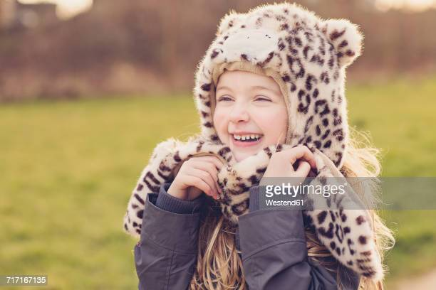 portrait of smiling little girl wearing hat with leopard print - leopard skin stock pictures, royalty-free photos & images