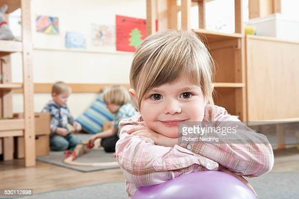 Portrait of smiling little girl with crossed arms