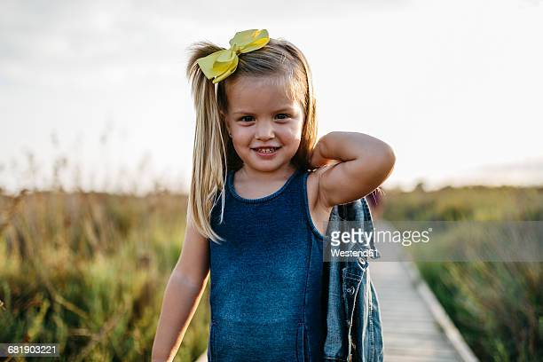 portrait of smiling little girl with hair ribbon - hair bow stock pictures, royalty-free photos & images