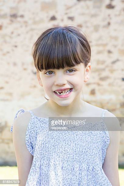 Portrait of smiling little girl with tooth gap