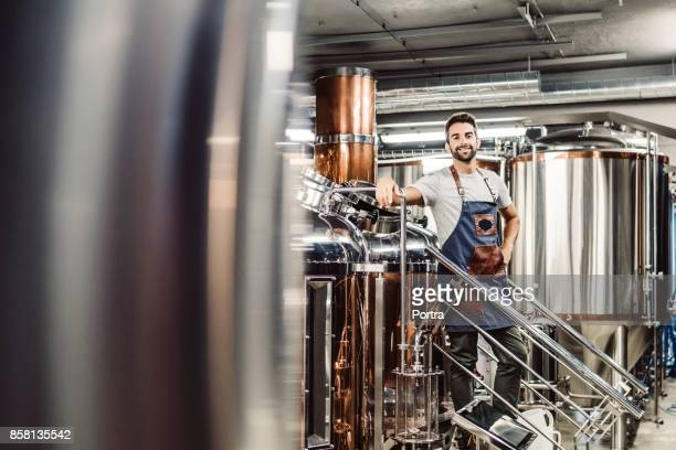 Portrait of smiling male manager at brewery